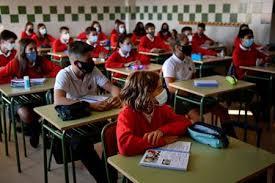 Pakistani students return to school as COVID-19 caseload drops