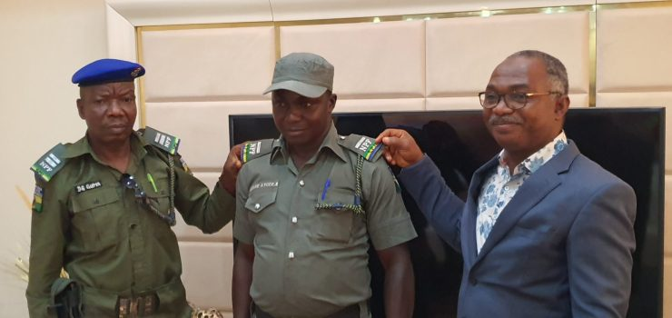 KAM Holding GMD decorates newly promoted Police cops