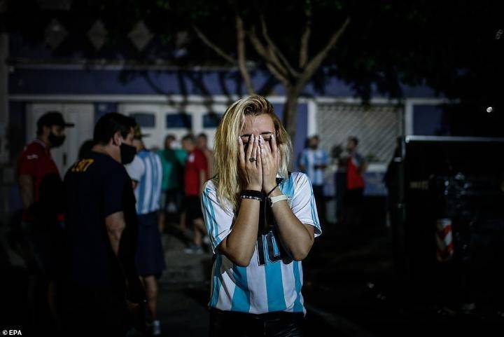 Diego Maradona's coffin arrives at Argentinian president's mansion to lie in state as weeping fans fill the streets to honour the lost hero (photos)