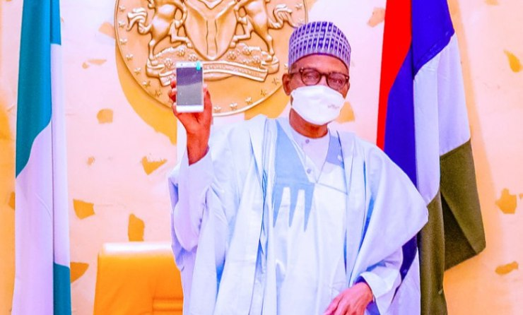Buhari Receives 1st Made in Nigeria cell phone