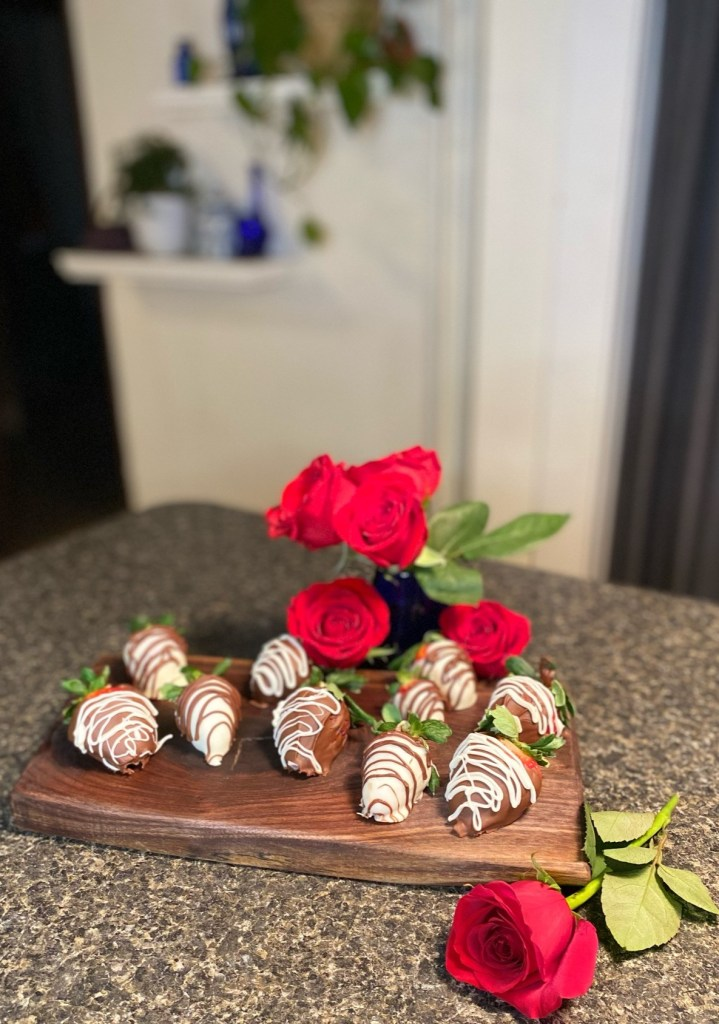 Simple Chocolate Dipped Strawberries on Walnut Board with Roses