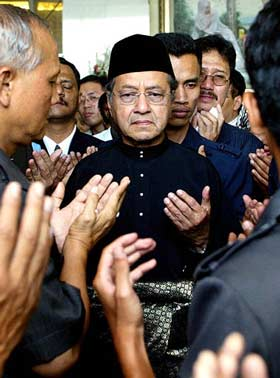 After handing power over to his successor, Datuk Seri Abdullah Ahmad Badawi, Tun Dr Mahathir Mohamad prays before leaving the prime minister's office in Putrajaya, Malaysia, Friday, Oct. 31, 2003.