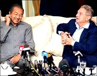 "George Soros, a self-made Hungarian-born billionaire, right, speaks with Dr Mahathir Mohamad during a joint news conference at a hotel in Kuala Lumpur, Malaysia, Friday, Dec. 15, 2006. Mahathir, who once called Soros a ""moron,"" met with him for the first time since the economic crisis made them bitter foes, and also explained to the Jewish billionaire that he (Mahathir) was not anti-Semitic despite his persistent criticism of Israel. (AP Photo)"