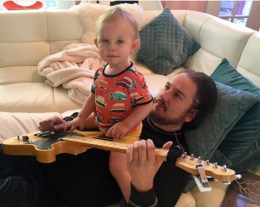 Roy Orbison Jr and Roy Orbison 3 playing guitar