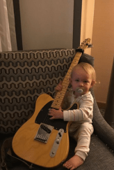 Roy Orbison 3's favorite toy is a guitar! He loves to play. He is 20 months old and already takes guitar lessons from a teacher. And I teach him a lottle everyday. We'll post another Roy 3 guitar video soon.