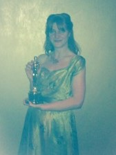 Rebecca Lenckiewicz holding the Oscar for best foreign film: Ida