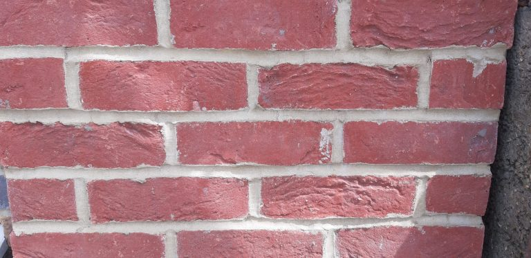 Accent red brick cladding close up scaled - Cladding and Finishes