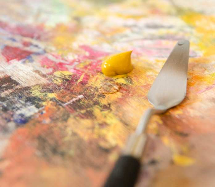 thinning yellow ochre oil paint with water on the palette