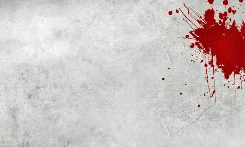 Imagem do podcast TESTE 9 do RPG Next - mancha se sangue em fundo quase branco