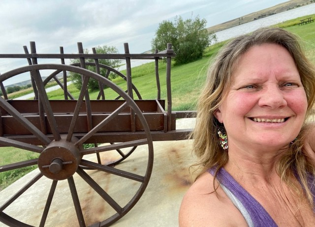 Lynne and a Red River Cart