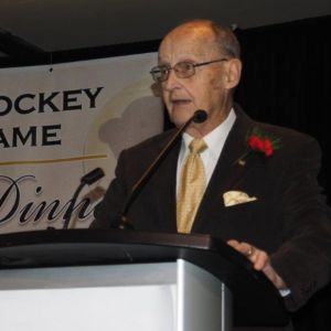 Photo of Gerry Varnes being inducted into MB Hockey Hall of Fame