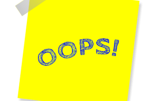 """Sticky note with """"oops"""" written on it."""