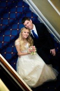 Bride and groom on the stairs at the Bournemouth Carlton Hotel