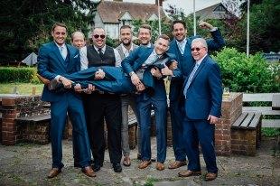 Best men holding the groom