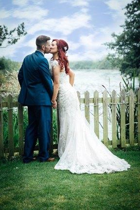 Bride and groom sharing a kiss at Sopley Mill