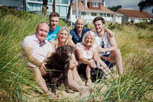 Family portrait with thier dog in the sand dunes