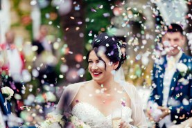 Bride under a shower of confetti at The Connaught Hotel Bournemouth
