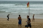 Even on a dull day, there are always folks on the beach at Manly.