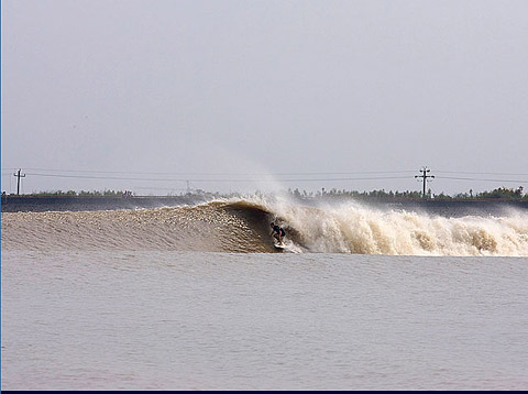 pic by A.J. Neste from Surfline.com: Rusty Long pulling into a barrel in the Qiantang river bore.