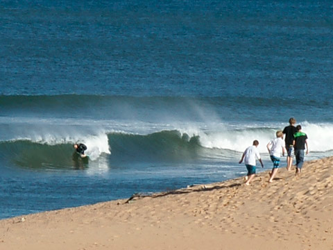 Wave(-let) of the day sweeps in around 1500 at N. Narrabeen.