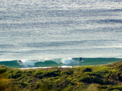 Fun looking little set wave tickles the strand.