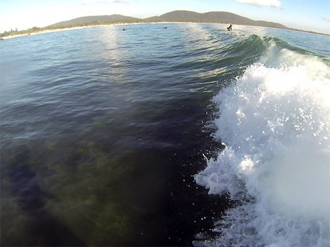 Glassy with occasional chest high sets.