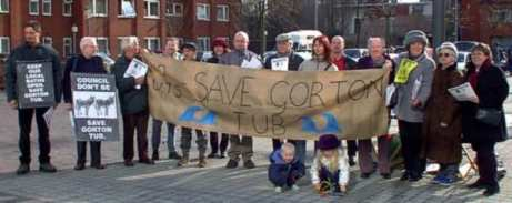 "Bartley with crowd behind ""Save Gorton Tub"" banner"