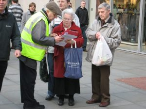 Bartley talking to two pensioners, petitioning
