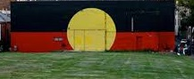 Aboriginal flag painted on a wall in Redfern