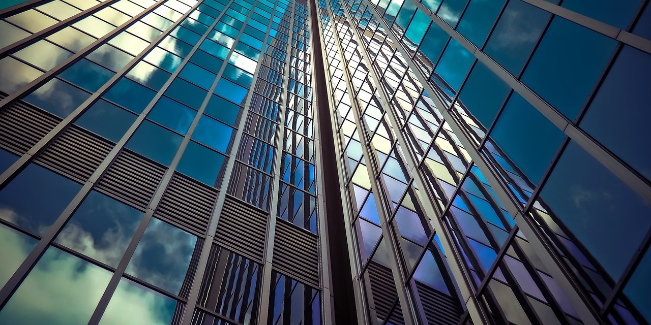 Skyscraper windows reflect the sky