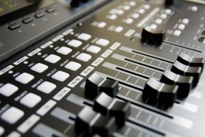 close up of a mixing board for sound recording
