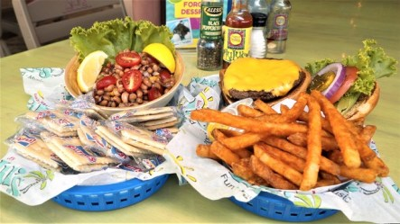 The L.A. Caviar, left, and the Crazy Sista's Version of Cheeseburger in Paradise are on the Alabama Tourism Department's list of 100 Dishes to Eat in Alabama Before You Die. (Chad Allen / Alabama NewsCenter)