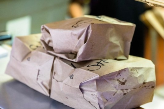 Long ago, Green Acres switched from white to brown bags because the grease shows up better. (Brittany Dunn / Alabama NewsCenter)