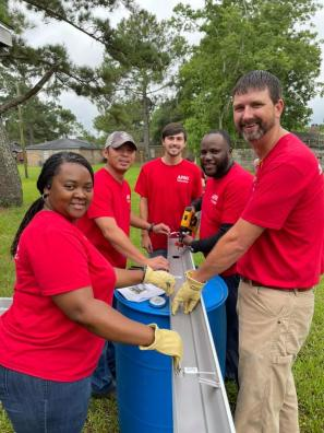 APSO volunteers install rain barrels in Prichard. (contributed)
