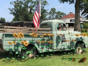 The pickup with sunflowers is one of the landmarks for Sweet South Market. (Michael Tomberlin / Alabama NewsCenter)