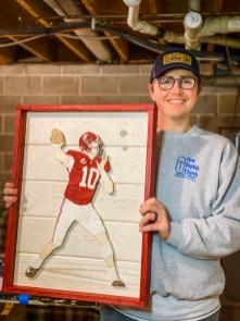 Nick Garrett with a Mac Jones portrait. (contributed)