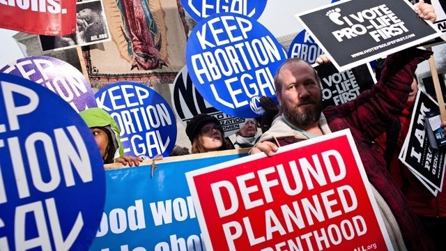 Abbott signs Texas law banning abortions as early as 6 weeks