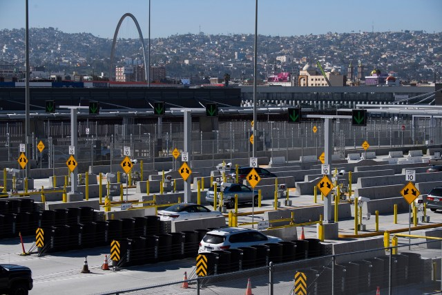 Vehicles enter a checkpoint as they approach the Mexico border at the US Customs and Border Protection San Ysidro Port of Entry at the US- Mexico border on February 19 in San Diego.