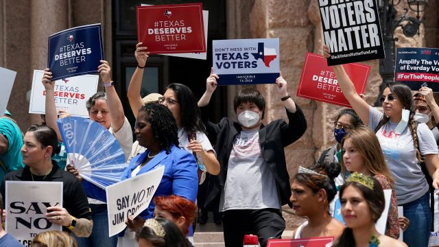 Demonstrators join a rally to protest proposed voting bills on the steps of the Texas Capitol