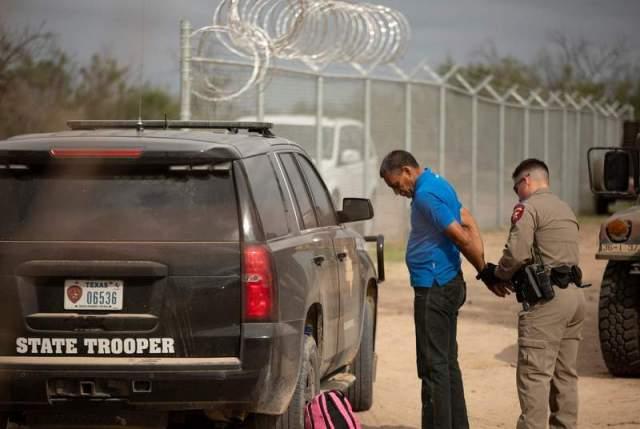 trooper arrests migrant 1