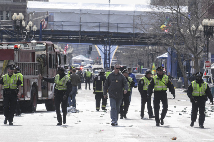 Public safety officials evacuate the scene after several explosions near the finish line of the 117th Boston Marathon in Boston, Massachusetts April 15, 2013 (Reuters / Jessica Rinaldi)
