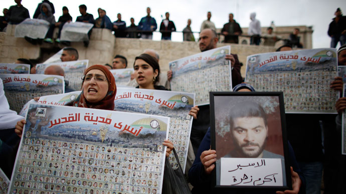 "Palestinians hold posters with pictures of Palestinian prisoners during a protest marking ""Palestinian Prisoners Day"" at Damascus Gate in Jerusalem's Old City April 17, 2013.(Reuters / Ammar Awad)"