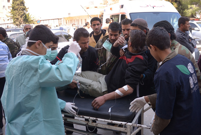In this image made available by the Syrian News Agency (SANA) on March 19, 2013, a man is brought to a hospital in the Khan al-Assal region in the northern Aleppo province, as Syria's government accused rebel forces of using chemical weapons for the first time (AFP Photo)