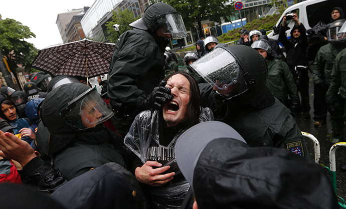 "German riot police scuffle with protestors in front of the European Central Bank (ECB) head quarters during a anti-capitalism ""Blockupy"" demonstration in Frankfurt, May 31, 2013. (Reuters / Kai Pfaffenbach)"