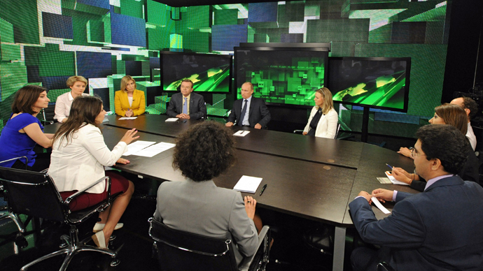 Russian President Vladimir Putin, far center, during his talk with Russia Today television channel's journalists and correspondents, June 11, 2013. (RIA Novosti / Michael Klimentyev)