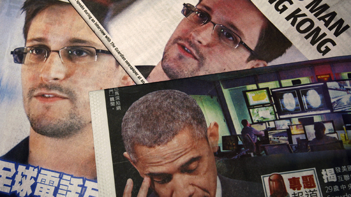 Photos of Snowden, a contractor at the NSA, and U.S. President Obama are printed on the front pages of local English and Chinese newspapers in Hong Kong in this illustration photo. (Reuters / Bobby Yip)