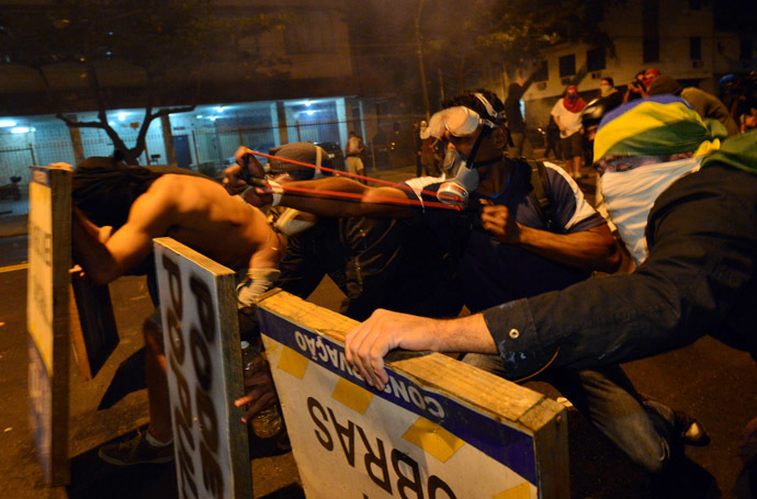 Violent demonstrators attack the police during a protest in a street near the Maracana stadium of Rio de Janeiro on June 30, 2013, a few hours before the final of the Fifa Confederations Cup football tournament between Brazil and Spain. (AFP Photo)