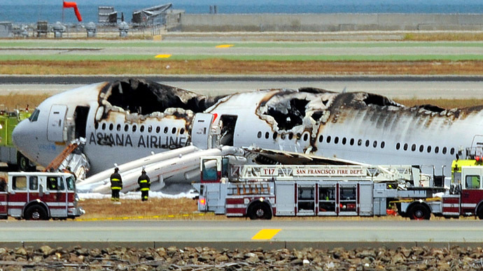 An Asiana Airlines Boeing 777 is seen on the runway at San Francisco International Airport after crash landing on July 6, 2013   (AFP Photo/Josh Edelson)