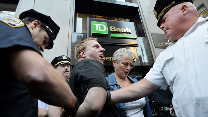 A man is arrested during the Occupy Wall Street protest September 17, 2012 on the one year anniversary of the movement in New York.(AFP Photo / Stan Honda)