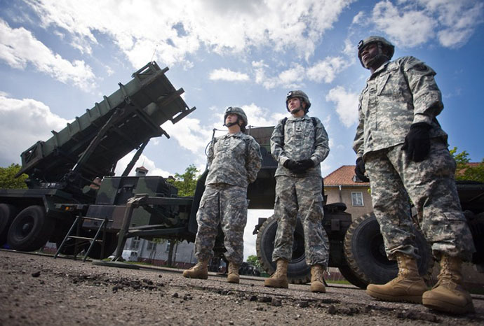 US soldiers stand in front of a Patriot missile battery at an army base in the northern Polish town of Morag. (AFP Photo / Wojtek Radwanski)